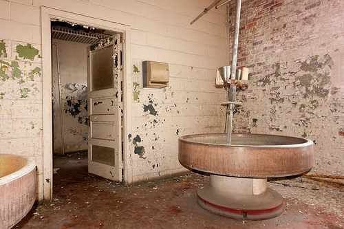 Bathroom with big round sinks aka. Bradley Washfountains. Abandoned Barber-Colman factory in Rockford, Illinois