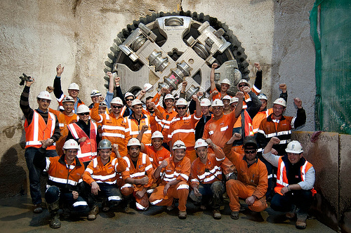 Workers in front of tunnel boring machine