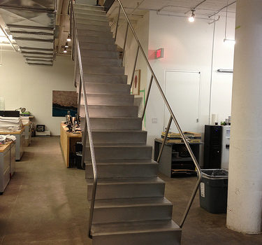 Blackened steel stair with stainless treads